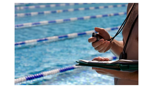 coach-timing-swimmer